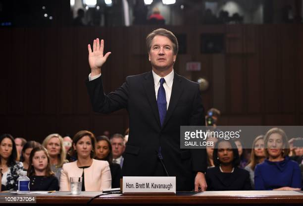 Judge Brett Kavanaugh is sworn in during his US Senate Judiciary Committee confirmation hearing to be an Associate Justice on the US Supreme Court on...