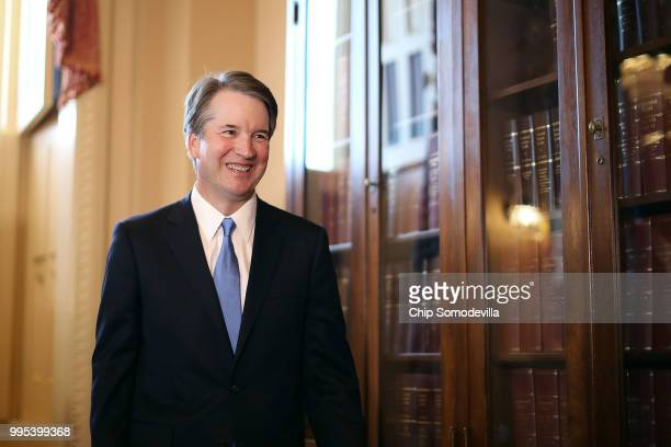 Judge Brett Kavanaugh leaves the room following a meeting and press availability with Senate Judiciary Committee Chairman Charles Grassley at the US...