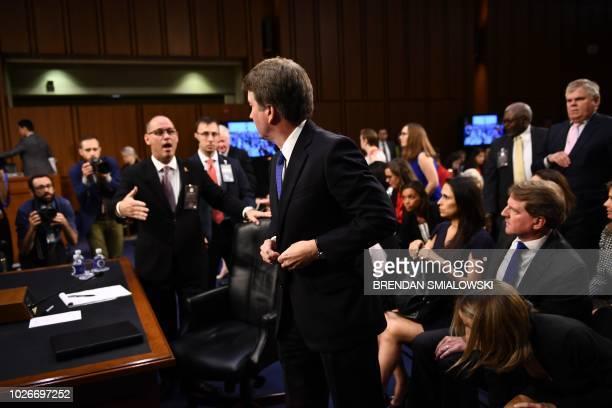 Judge Brett Kavanaugh listens to Fred Guttenberg father of Parkland Florida shooting victim Jaime Guttenberg as Kavanaugh gets up during his US...