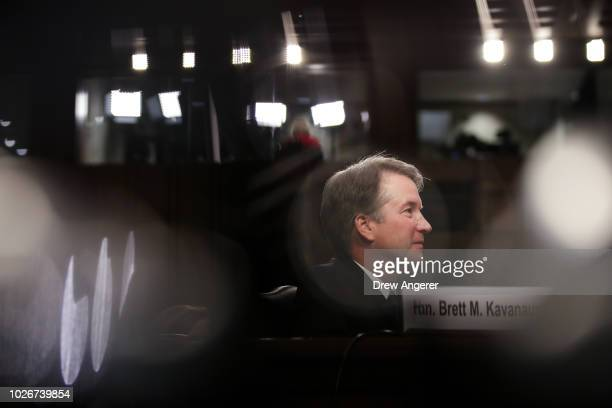 Judge Brett Kavanaugh listens to opening statements during his Supreme Court confirmation hearing before the Senate Judiciary Committee in the Hart...