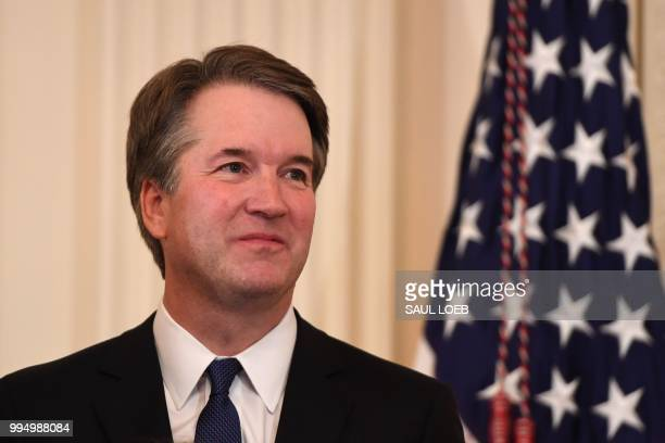 Judge Brett Kavanaugh looks on as the US President announces him as his nominee to the Supreme Court in the East Room of the White House on July 9,...