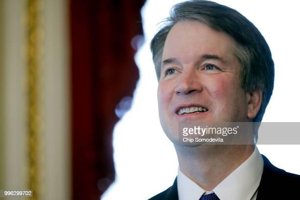Judge Brett Kavanaugh poses for journalists before a meeting with Senate Finance Committee Chairman Orrin Hatch in the Senate President pro tempore...