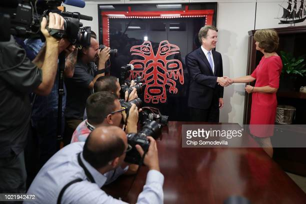 Judge Brett Kavanaugh shakes hands with Sen. Lisa Murkowski for photographers before their meeting in the Hart Senate Office Building on Capitol Hill...