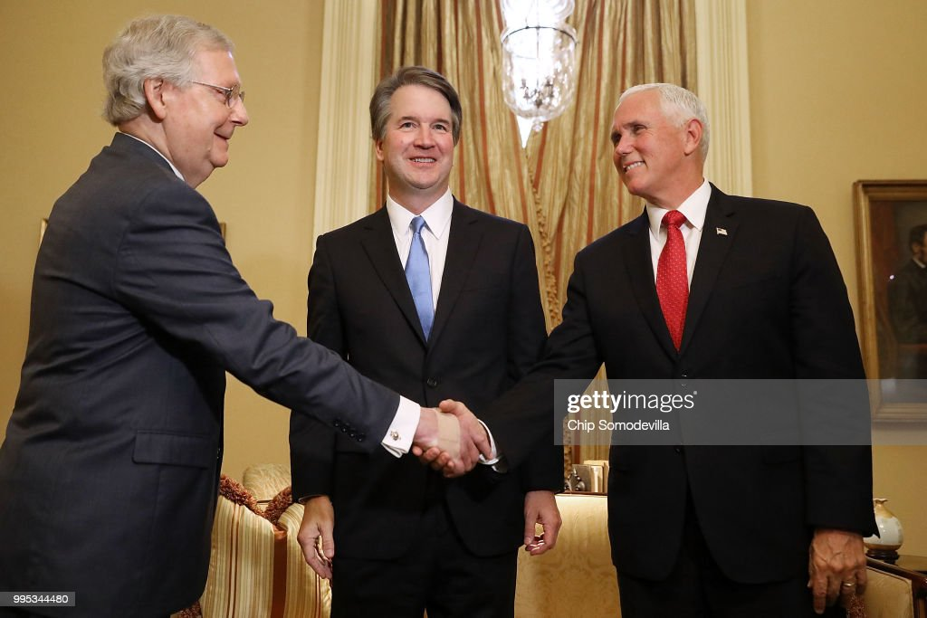 Judge Brett Kavanaugh (C) stands by as Senate Majority Leader Mitch McConnell (R-KY) (L) greets Vice President Mike Pence (R) before a meeting in McConnell's office in the U.S. Capitol July 10, 2018 in Washington, DC. U.S. President Donald Trump nominated Kavanaugh to succeed retiring Supreme Court Associate Justice Anthony Kennedy.