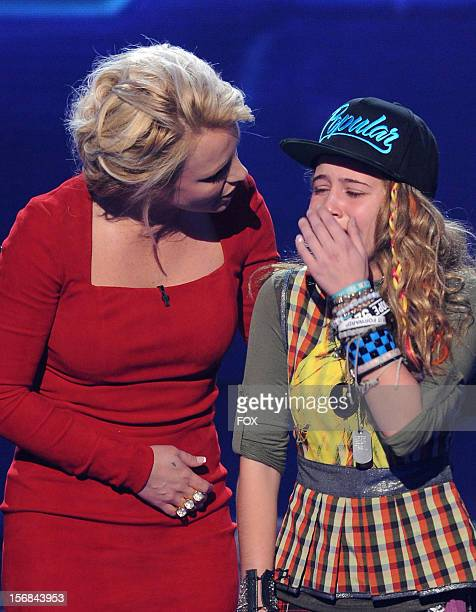 """Judge Britney Spears and eliminated contestant Beatrice Miller onstage at FOX's """"The X Factor"""" Season 2 Top 10 to 8 Live Elimination Show on November..."""