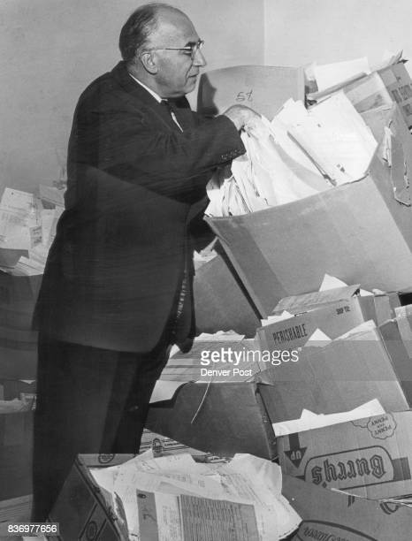 Judge Clears Court Files Denver Probate Judge David Brofman checks receipts from estates filed from September 1942 to February 1954 before destroying...