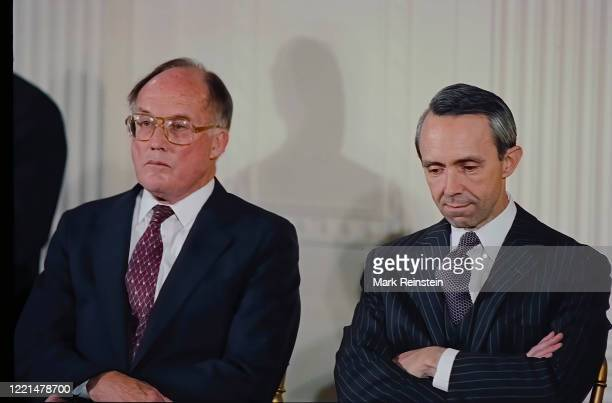 Judge David Souter and Chief Justice of the United States William Rehnquist listen to remarks by President George H.W. Bush prior to Souter being...