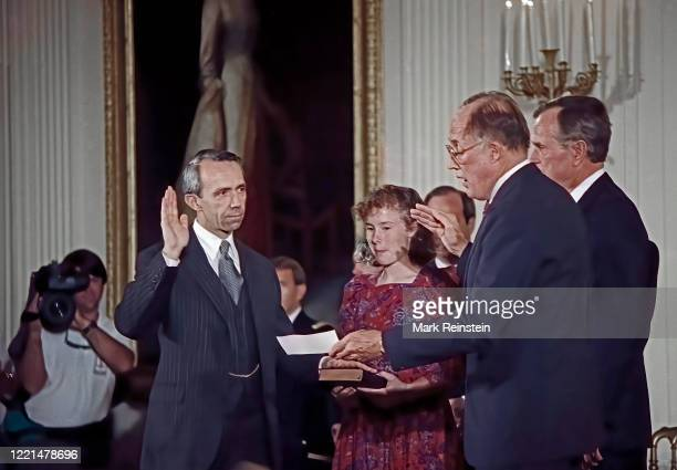 Judge David Souter with his right hand raised as Chief Justice of the United States William Rehnquist delivers the oath of office. Erin Rath daughter...
