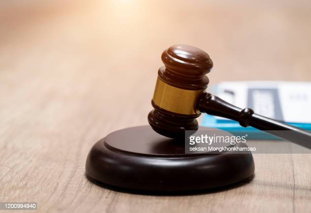 judge gavel and scale in court. legal concept - crime or recreational drug or prison or legal trial stock-fotos und bilder