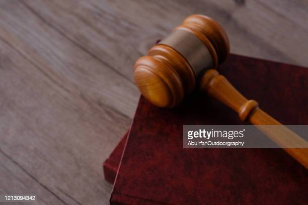 judge gavel with books on wooden table - legal trial stock pictures, royalty-free photos & images