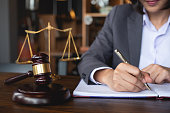 Judge gavel with Justice lawyers, Business woman in suit or lawyer working on a documents. Legal law, advice and justice concept.