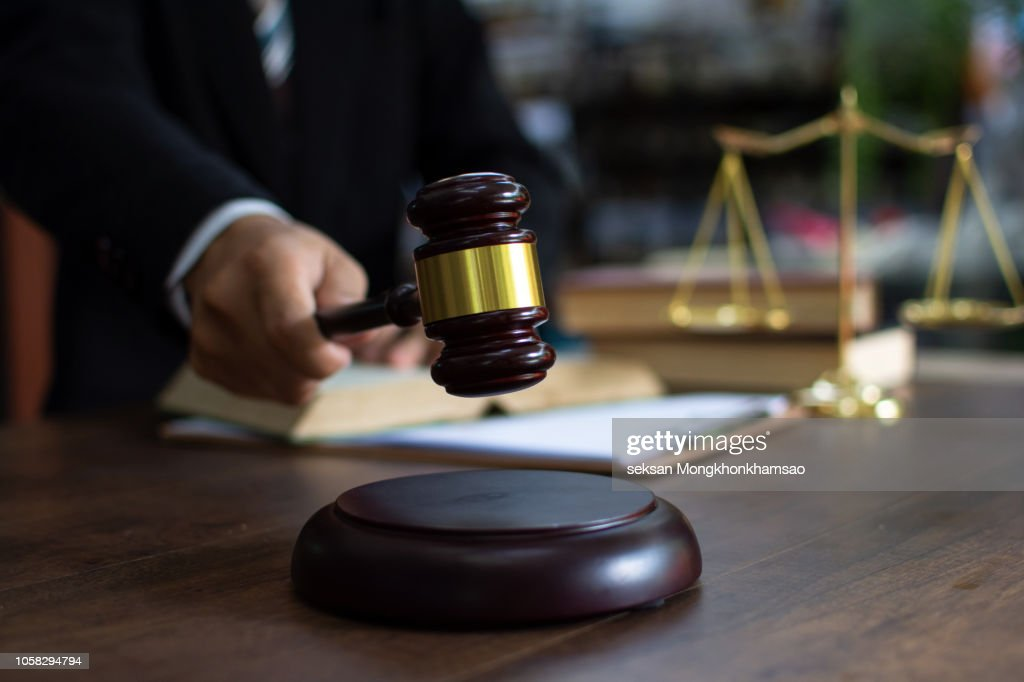 Judge gavel with Justice lawyers, Businessman in suit or lawyer working on a documents. Legal law, advice and justice concept. : Stock Photo