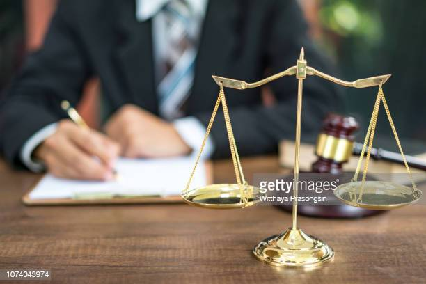 judge gavel with justice lawyers, businessman in suit or lawyer working on a documents. - legislation stock pictures, royalty-free photos & images