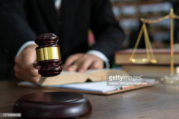 judge gavel with justice lawyers, businessman in suit or lawyer working on a documents. legal law, advice and justice concept. - judge law stock pictures, royalty-free photos & images
