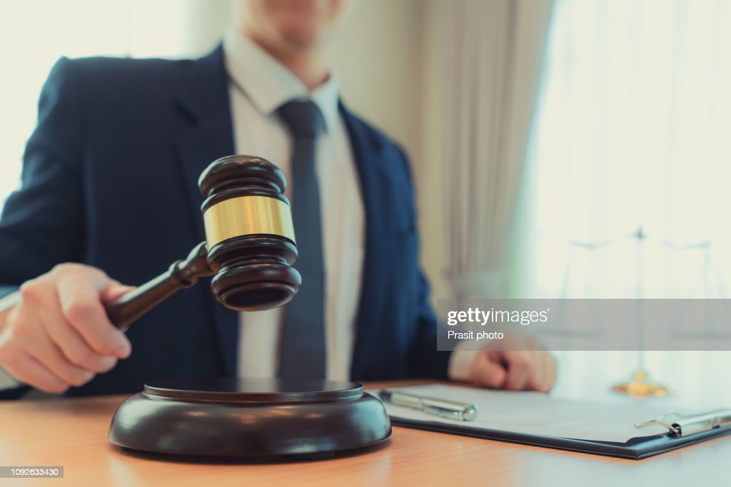 Judge gavel with Justice lawyers, counselor in suit or lawyer working on a documents at law firm in office. : ストックフォト