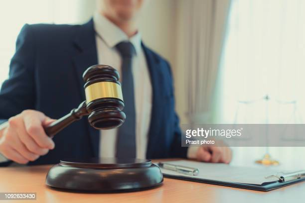 judge gavel with justice lawyers, counselor in suit or lawyer working on a documents at law firm in office. - 最高裁判事 ストックフォトと画像