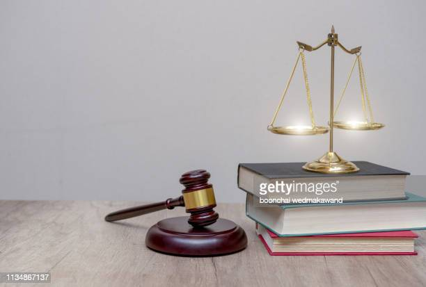 judge gavel with law books and scales of justice. concept of justice, legal, jurisprudence. wide view. - crime or recreational drug or prison or legal trial stock-fotos und bilder