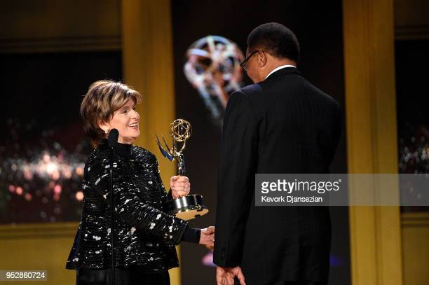 Judge Greg Mathis winner of Outstanding Legal/Courtroom Program for 'Judge Mathis' accepts award from Gloria Allred onstage during the 45th annual...