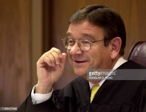 Judge Guy Burningham questions the prosecution during a hearing for convicted bigamist Tom Green 27 June 2001 in Provo Utah Green will not have to...