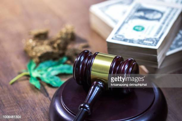 judge hammer with sound block on the desk background - legality of cannabis, legal and illegal cannabis on the world. - lawsuit stock pictures, royalty-free photos & images