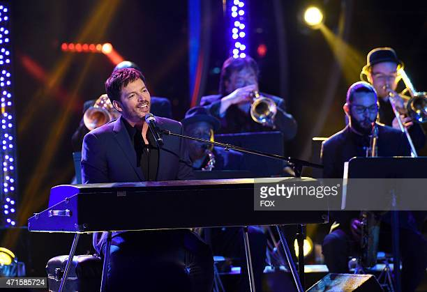 Judge Harry Connick Jr performs onstage at FOX's American Idol XIV Top 4 Revealed on April 22 2015 in Hollywood California