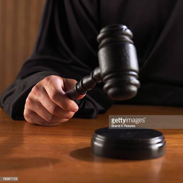 Judge hitting gavel