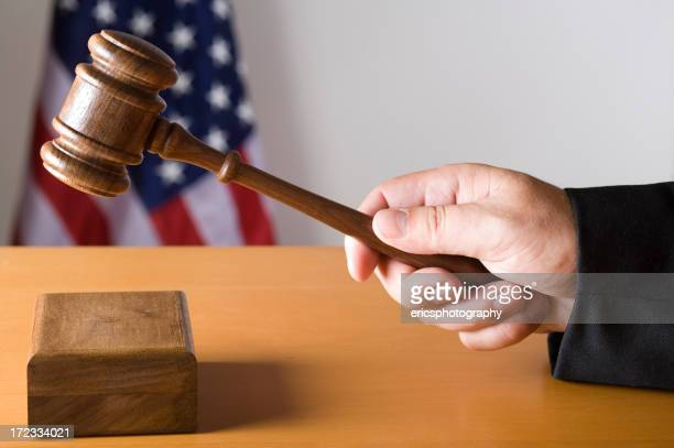 Judge hitting sound box with gavel