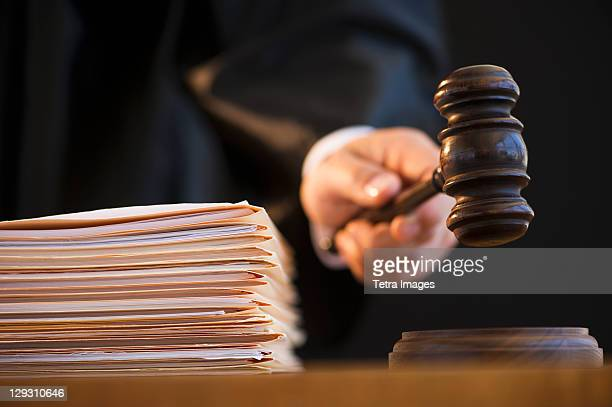 judge holding gavel, close-up - crime or recreational drug or prison or legal trial stock-fotos und bilder