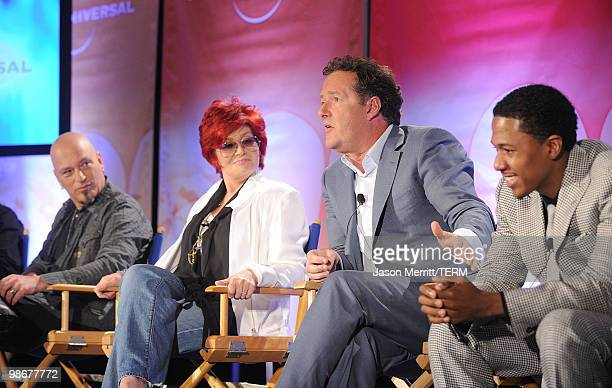 Judge Howie Mandel, judge Sharon Osbourne, judge Piers Morgan, and host Nick Canon talk with reporters at the NBC Universal Summer Press Day on April...