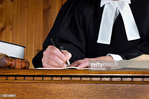judge in robes taking notes. - canadian culture stock pictures, royalty-free photos & images