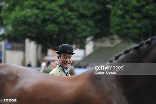 A judge in the Hunter class looks on at the RDS Dublin Horse Show at Royal Dublin Society on August 7 2013 in Dublin Ireland