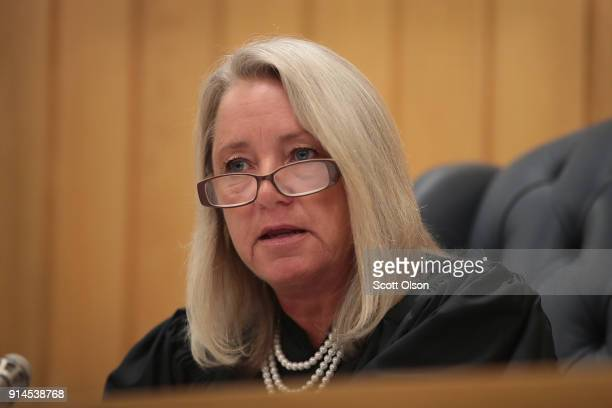 Judge Janice Cunningham reads a statement as she sentences Larry Nassar for three counts of criminal sexual assault in Eaton County Circuit Court on...