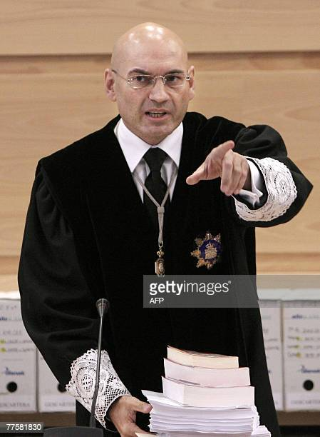 Judge Javier Gomez Bermudez gestures prior to the start of the Madrid bombings trial at the National High Court before the reading of the 2004 Madrid...