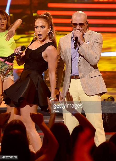 Judge Jennifer Lopez and singer Pitbull perform onstage at FOX's American Idol XIV Finale on May 13 2015 at the Dolby Theater in Hollywood California