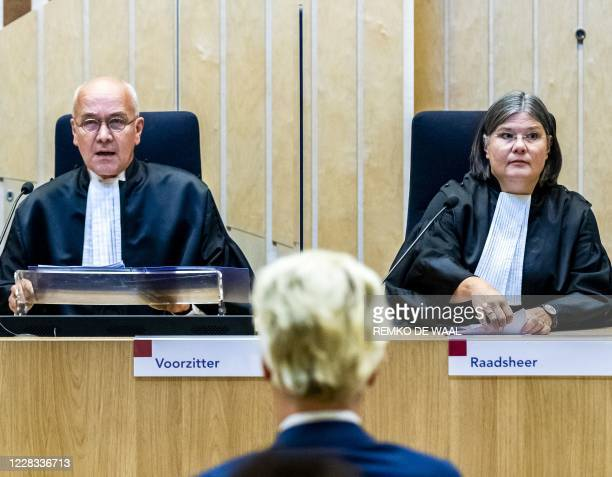 Judge JM Reinking and Dutch far-right Freedom Party Geert Wilders sit in the court of appeal in The Hague, during the court's ruling in the 2014...