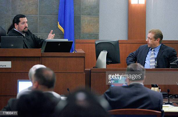 Judge Joe Bonaventure Jr talks to Charles Cashmore one of the OJ Simpson robbery case codefendants who plead guilty to a reduced charge testifies...