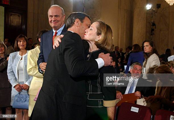 Judge John G Roberts Jr hugs his wife Jane Sullivan Roberts after the first day of the Senate Judiciary Committee hearing on his nomination for the...