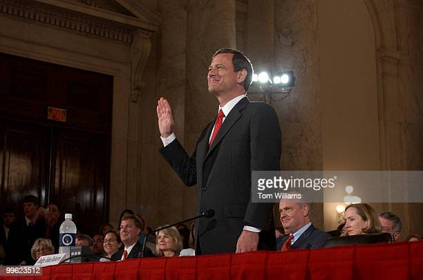 Judge John G Roberts Jr is sworn in on the first day of the Senate Judiciary Committee hearing on his nomination for the chief justice of the United...