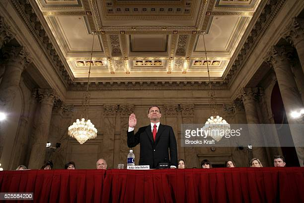 Judge John G Roberts raises his right hand as he is sworn in before the Senate Judiciary Committee to testify on his confirmation to become the chief...