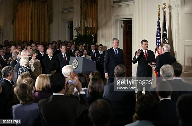 Judge John Roberts, center, is sworn in as the 17th Chief Justice of the United States by Associate Supreme Court Justice John Paul Stevens, right,...