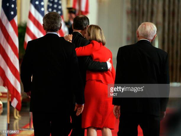 Judge John Roberts kisses is wife, Jane after being sworn in by Supreme Court Justice John Paul Stevens, Thursday, Sept. 29 as the 17th Chief Justice...