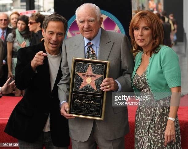 Judge Joseph A Wapner poses with a copy of his star beside Harvey Levin from the website TMZ and Judge Marilyn Milian after he was honored with a...