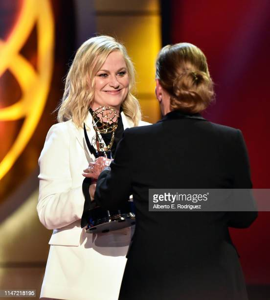 Judge Judy accepts the Lifetime Achievement Award from Amy Poehler onstage at the 46th annual Daytime Emmy Awards at Pasadena Civic Center on May 05...