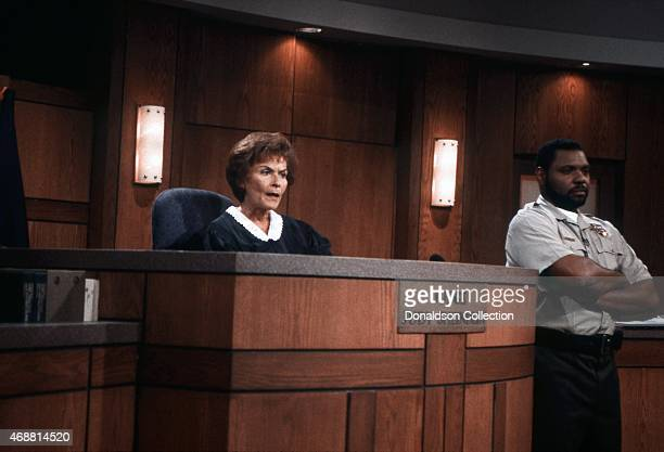 Judge Judy Judith Sheindlin and bailiff Petri HawkinsByrd on Set on February 14 1997 in Los Angeles California