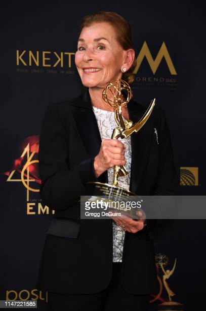 Judge Judy poses with the Lifetime Achievement Award in the press room during the 46th annual Daytime Emmy Awards at Pasadena Civic Center on May 05,...