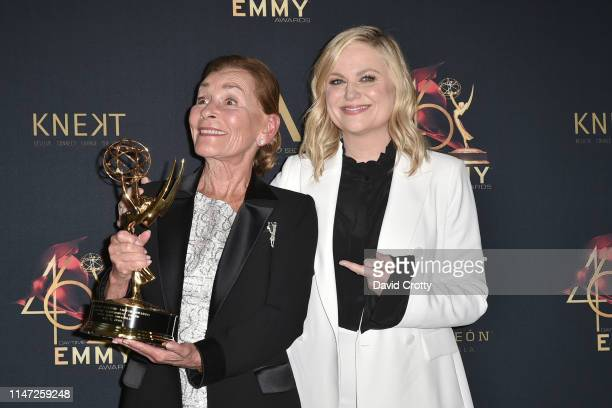 Judge Judy Sheindlin, with her Lifetime Achievement Award, and Amy Poehler attend the 46th Annual Daytime Emmy Awards - Press Room at Pasadena Civic...
