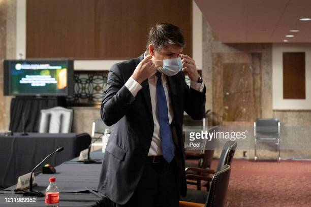 Judge Justin Walker puts on a mask after testifying before a Senate Judiciary Committee hearing on his nomination to be United States Circuit Judge...