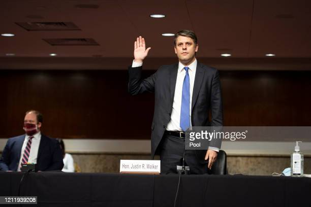 Judge Justin Walker swears in before testifying before a Senate Judiciary Committee hearing on his nomination to be United States Circuit Judge for...