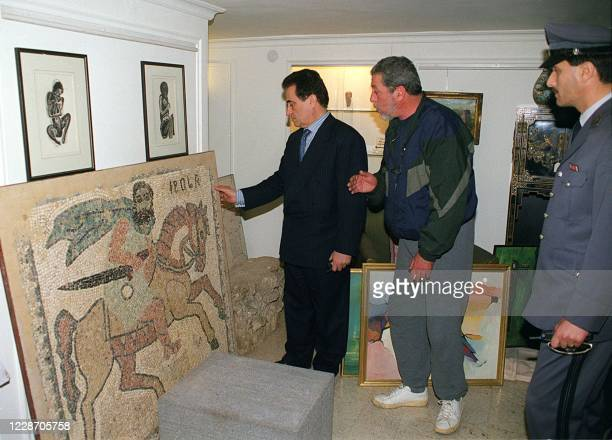Judge Khaled Hammoud , public prosecutor for financial fraud, checks ancient mosaics in a private home in Beirut, 18 March 1999. Lebanese police have...