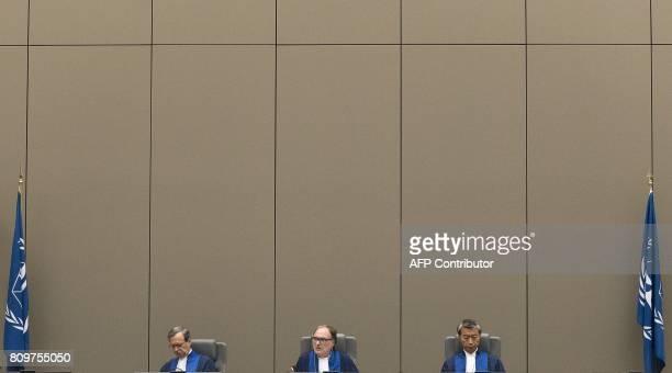 Judge Marc Perrin de Brichambaut of France Presiding judge Cuno Tarfusser of Italy and judge Changho Chung of Korea run the International Criminal...